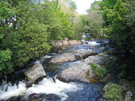 "The River Erme with the Bridge in the distance"" hspace="