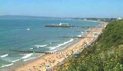 "The beach at Bournemouth seen from the cliffs"" hspace="