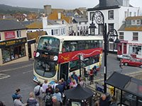 "X53 bus at bus stop picking up passengers for Exeter"" hspace="